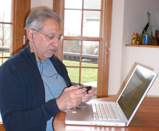 Too old to multitask? The author texting while writing on a laptop and listening to tunes.