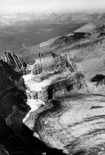 Oblique view of Grinnell Glacier taken from the summit of Mount Gould, Glacier National Park in 1938.  The glacier has since largely receded.  In addition to glacier melt, rising temperatures will lead to unprecedented pressures on our agricultural systems and social infrastructure, writes Andrew T. Guzman. Image by T.J. Hileman, courtesy of Glacier National Park Archives.