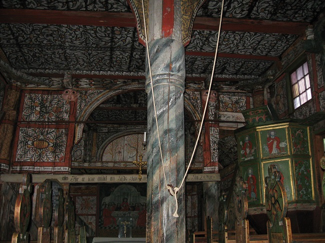 The central pillar supporting the roof structure of the Uvdal Stave Church.