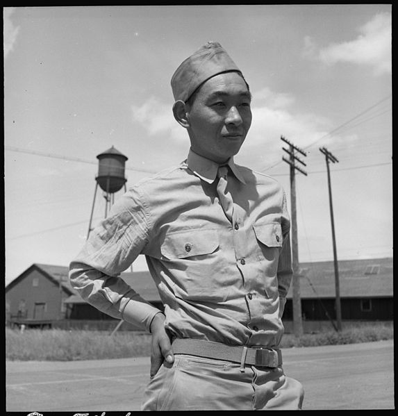 A young Japanese American soldier, given leave to assist his family with relocation.