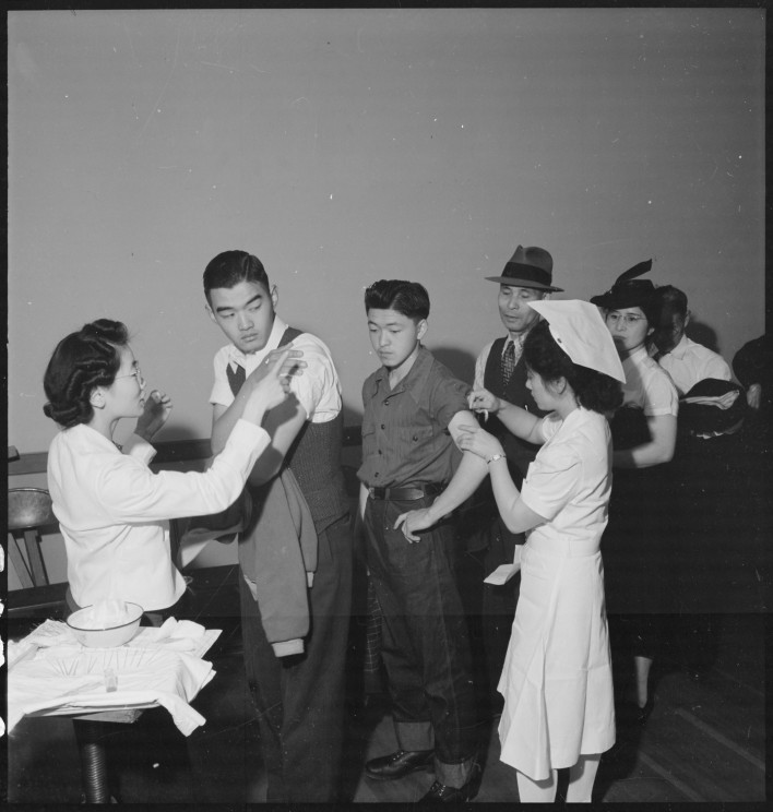 Japanese Americans being inoculated as they registered for evacuation in San Francisco.