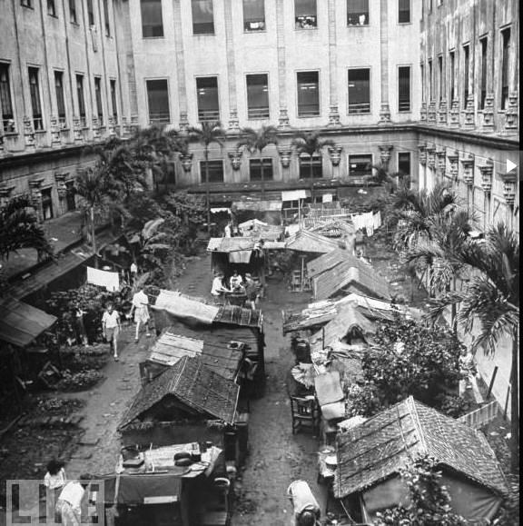 Residents in the Santo Tomas Internment Center constructed outdoor shanties to find space beyond their limited shelter.