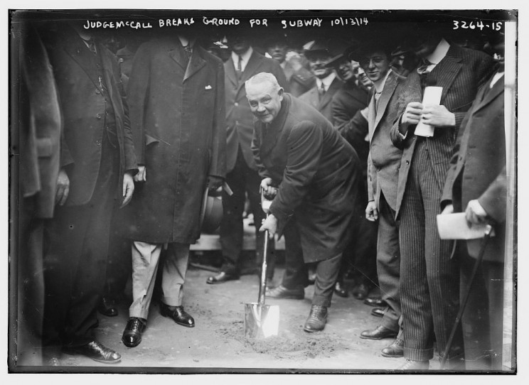 Edward Everett McCall (1863-1924), Chairman of the New York (State) Public Service Commission, with shovel, breaking ground for a subway in New York City. October 13, 1914. Courtesy of the Library of Congress.