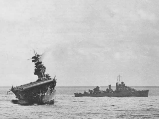The U.S. Navy aircraft carrier USS Yorktown (CV-5) being abandoned by her crew after she was hit by two Japanese Type 91 aerial torpedoes, 4 June 1942.