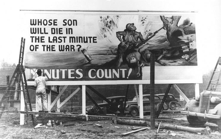 The poster refers to the deployment of the atomic bombs in anticipation of the expected huge sacrifices of the invasion of Japan in 1945. Photograph of the legendary Ed Westcott; the image is in public domain, courtesy of Oak Ridge National Laboratory.