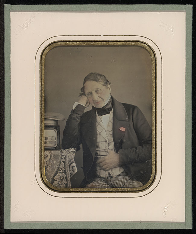 Jean-Gabriel Eynard, daguerreotypist (Swiss, 1775 - 1863) Self-Portrait with a Daguerreotype of Geneva, about 1847, Daguerreotype, hand-colored 1/4 plate Image: 9.7 x 7.3 cm (3 13/16 x 2 7/8 in.) Object (whole): 15.2 x 12.7 cm (6 x 5 in.) The J. Paul Getty Museum, Los Angeles