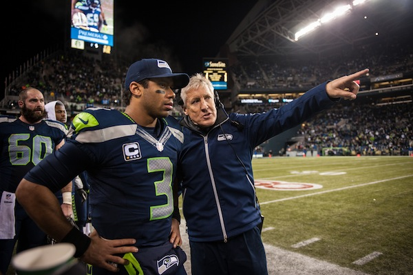 Russell Wilson listens as Pete Carroll gives instructions near the end of the game. Image credit: Seattle Seahawks Organization