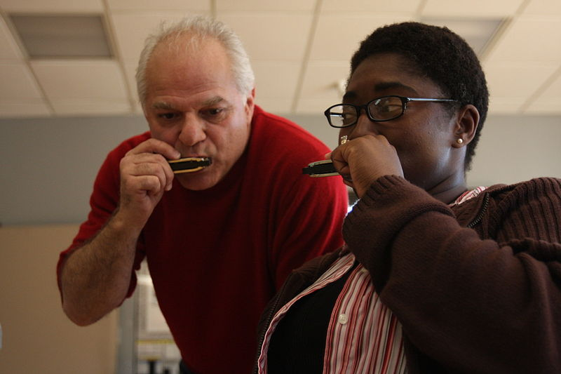 Rand De Mattei, a music instructor with Blues in the Schools, gets in tune with Petty Officer 2nd Class Tyreen S. McRae, a participant in neurologic music therapy, at Naval Medical Center San Diego Feb. 28. Neurologic music therapy helps Wounded Warriors recover.