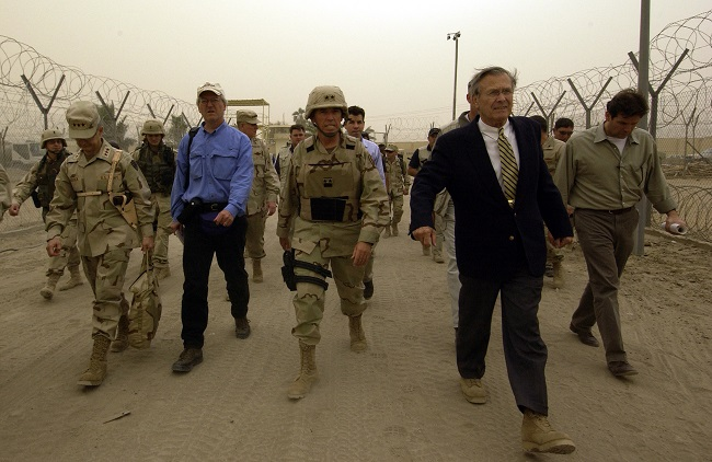 Secretary of Defense Donald H. Rumsfeld takes a tour of the Abu Ghraib Detention Center in Abu Ghraib, Iraq, on May 13, 2004. Rumsfeld and Chairman of the Joint Chiefs of Staff Gen. Richard B. Myers are in Iraq to visit the troops in Baghdad and Abu Ghraib.   DoD photo by Tech. Sgt. Jerry Morrison Jr., U.S. Air Force. Public domain via defense.gov.