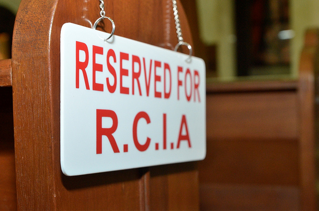 Sign reserving pews for the Catechumens.