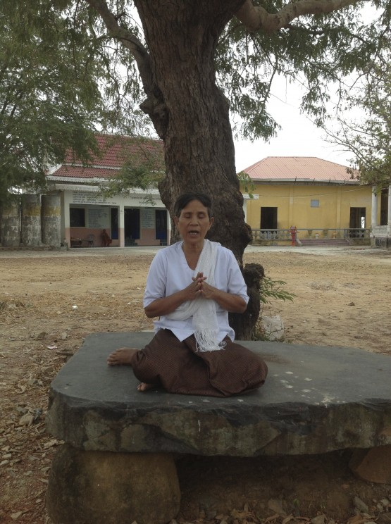 Smot teacher Keot Ran chants smot on temple grounds in Kampong Speu province, Cambodia. Photo by Catherine Grant, February 2013.