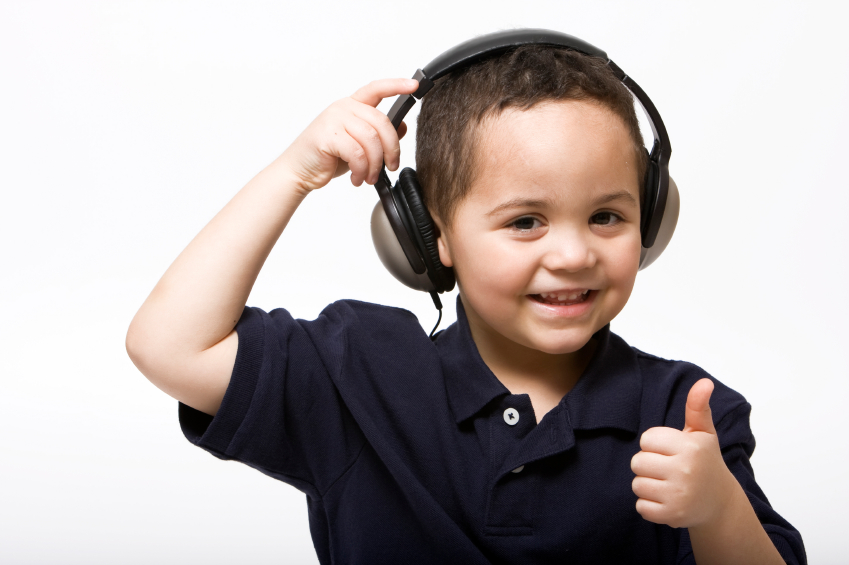 Boy giving thumbs up headphones