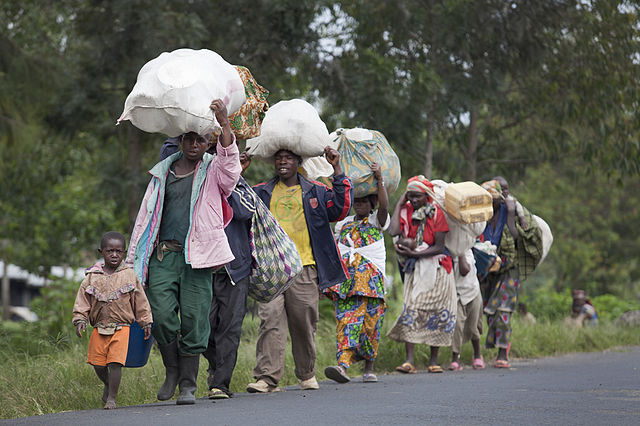 Population fleeing their villages due to fighting between FARDC and rebel groups, Sake North Kivu, 30 April 2012. Photo by MONUSCO/Sylvain Liechti CC BY-SA 2.0 via Wikimedia Commons