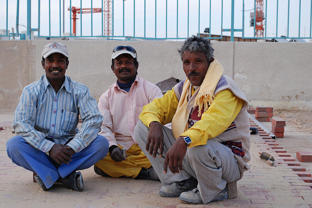 Builders at Work: There are close to one million migrant workers in Qatar, mainly from South Asia. The majority work in construction. Photo by WBUR Boston's NPR News Station. CC BY-NC-ND 2.0 via wbur Flickr.