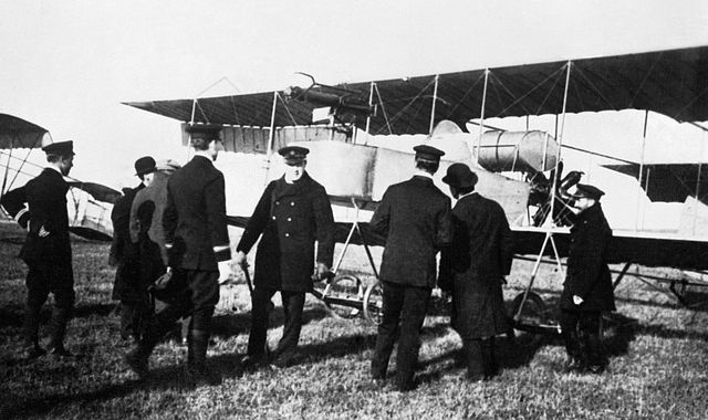 Winston Churchill with the Naval Wing of the Royal Flying Corps, 1914. Public domain via Wikimedia Commons.