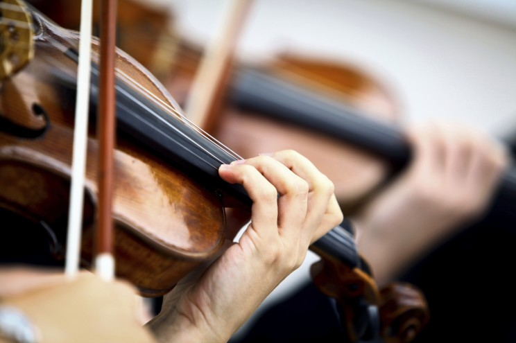 Detail of violin being played by a musician. © bizoo_n via iStockphoto.
