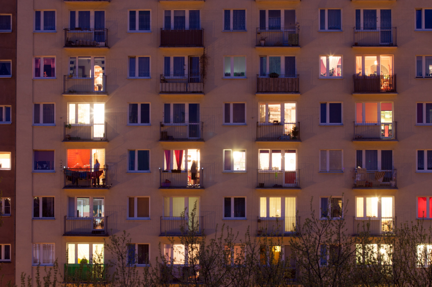 Window of an apartment block at night. © bartosz_zakrzewski  via iStockphoto.