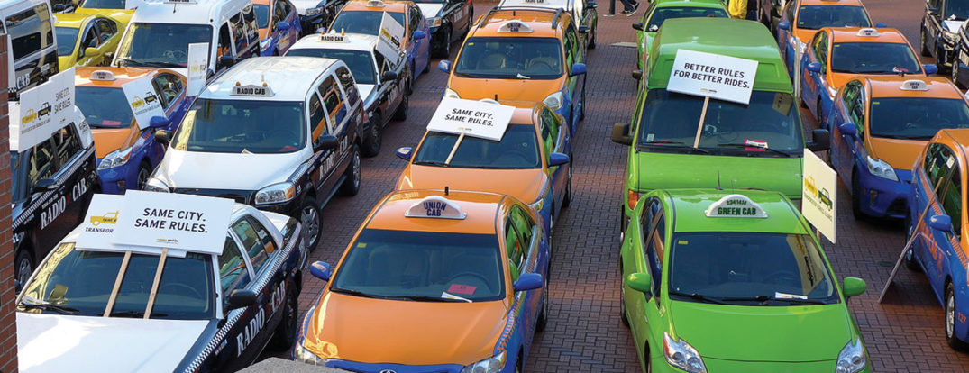 January 13, 2015, around 70 of Portland's 460 Taxi cabs protested fair taxi laws by parking in Pioneer square. Photo by Aaron Parecki CC BY 2.0 via Wikimedia Commons.