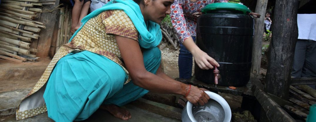 Louiza Zhang watches as ……………….. washes her household pots with water collected from the village gravity flow taps and stores them on the advised drying racks. At a NEWAH WASH water project in Puware Shikhar, Udayapur District, Nepal.